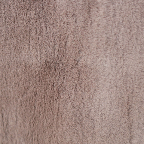 Faux fur fabric in sable brown that is very soft to the touch. Suitable for upholstery, toss cushions, pillows and other home decor accessories. #tonicliving
