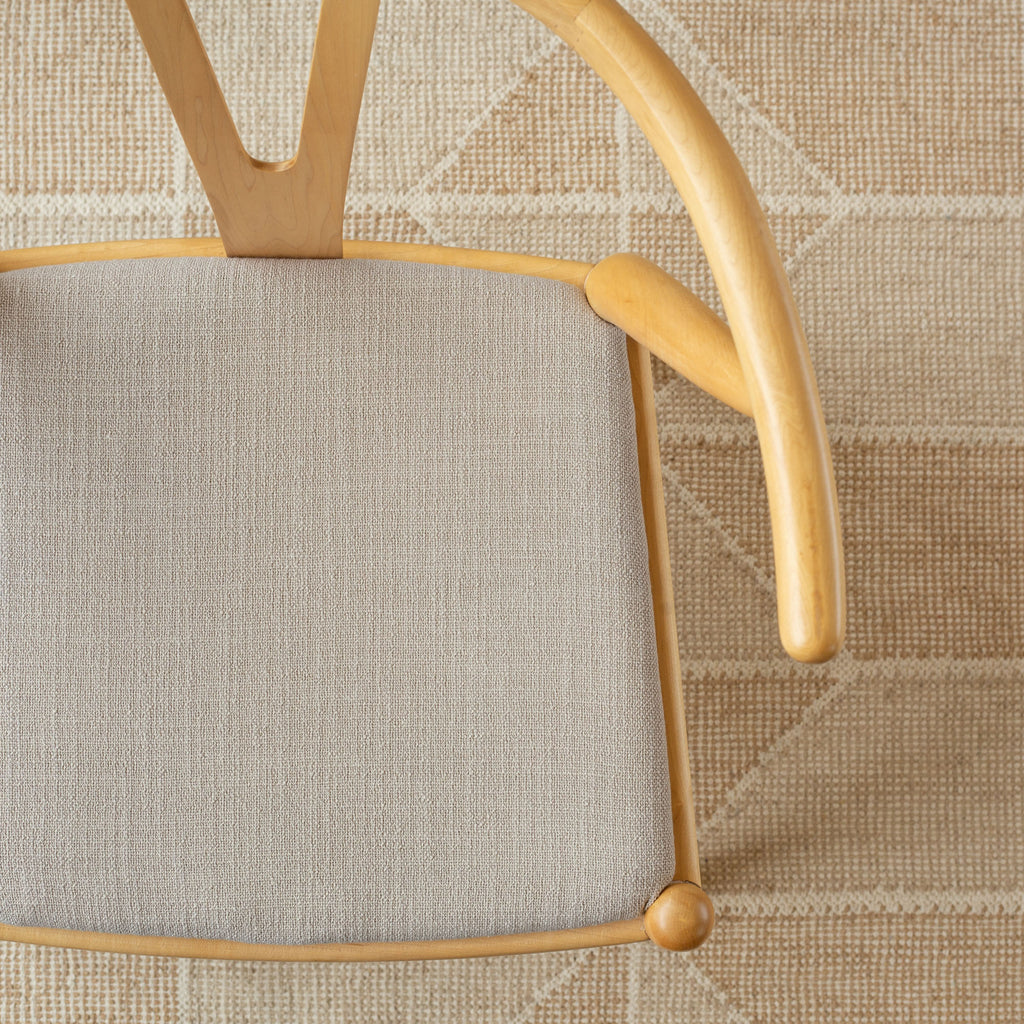 Grange Fabric Pumice, an earthy grey high performance upholstery fabric  shown on a chair