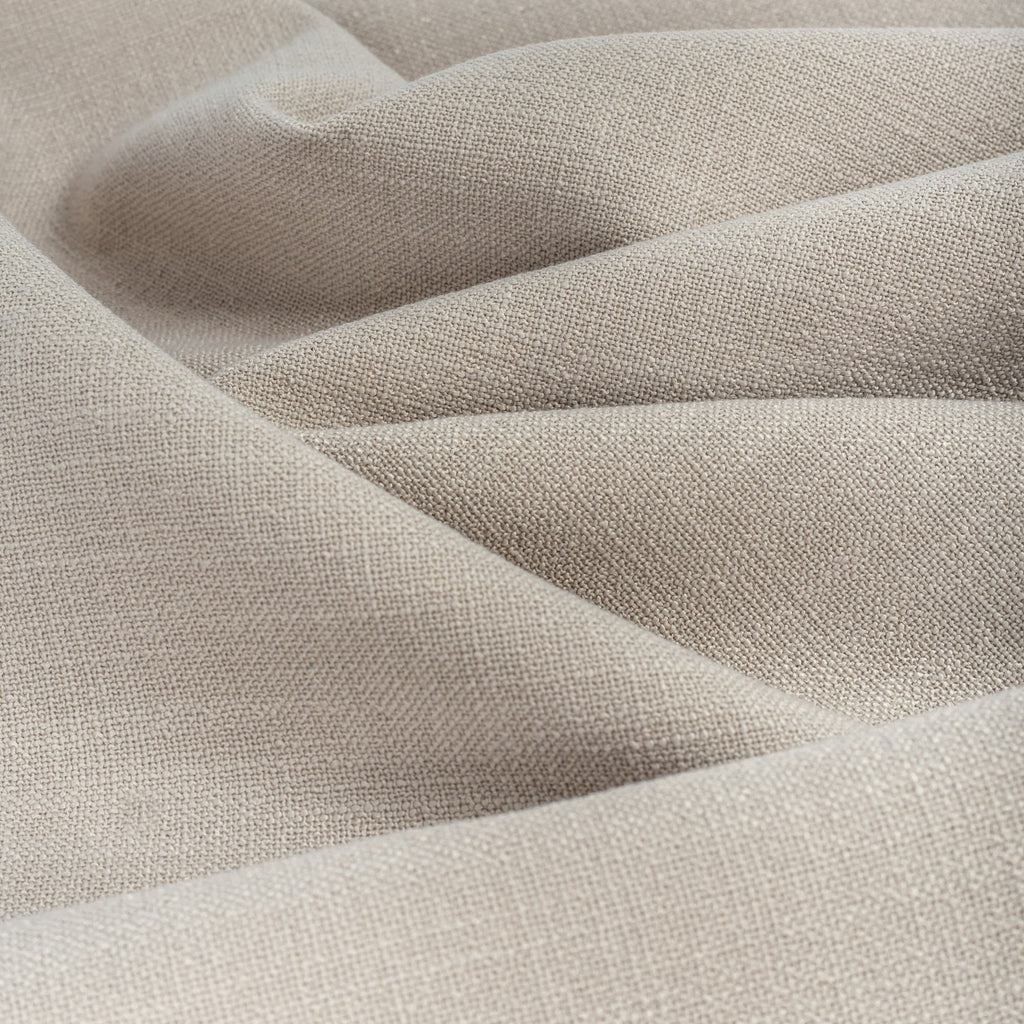 Grange Fabric Pumice, an earthy grey high performance upholstery fabric with a subtle textural weave from Tonic Living