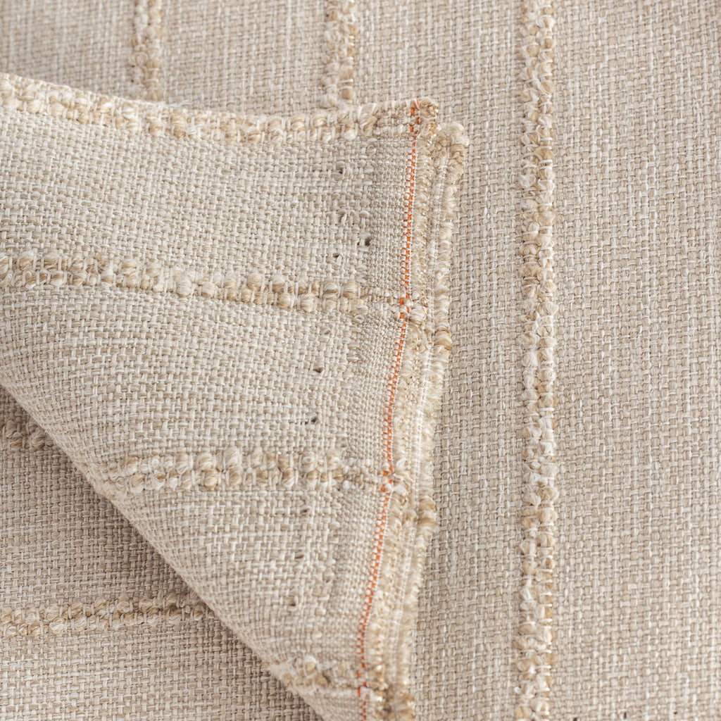 a creamy straw toned fabric with a chunky tonal stripe