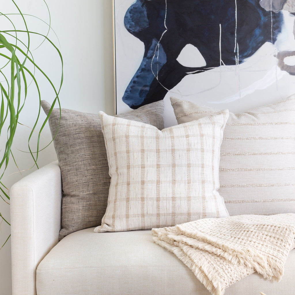 Neutral decor: Stanhope ash grey, Harriet ivory beige check and Handlavet beige stripe pillow combination