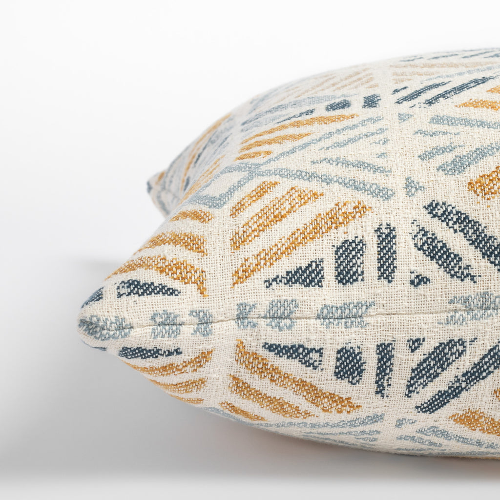 Isla Laguna blue, yellow and beige geometric pattern indoor outdoor pillow : close up side