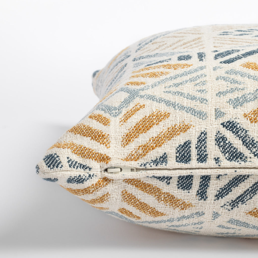 Isla Laguna blue, yellow and beige geometric pattern indoor outdoor pillow : close up zipper