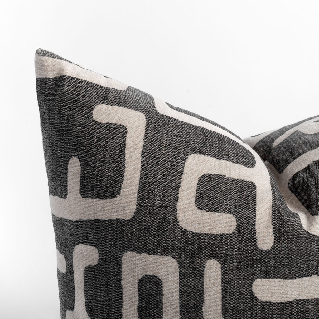 Karru charcoal gray and beige abstract print pillow close up view