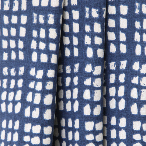 Lagos, Indigo - A block printed look in an inky indigo blue on a natural background.