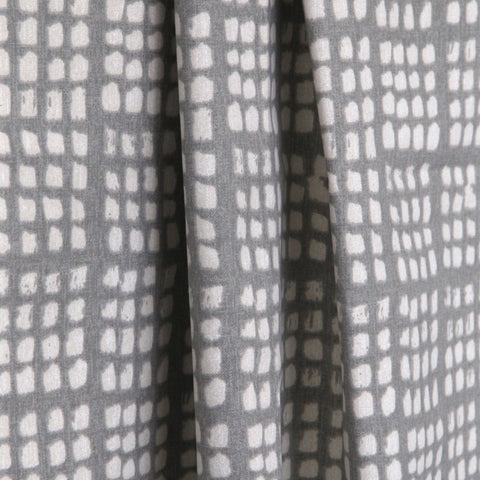 Lagos, Platinum - A block printed look in a washed out soft grey on a natural background.
