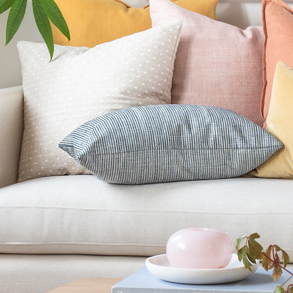 Colorful pillows on a sofa from Tonic Living