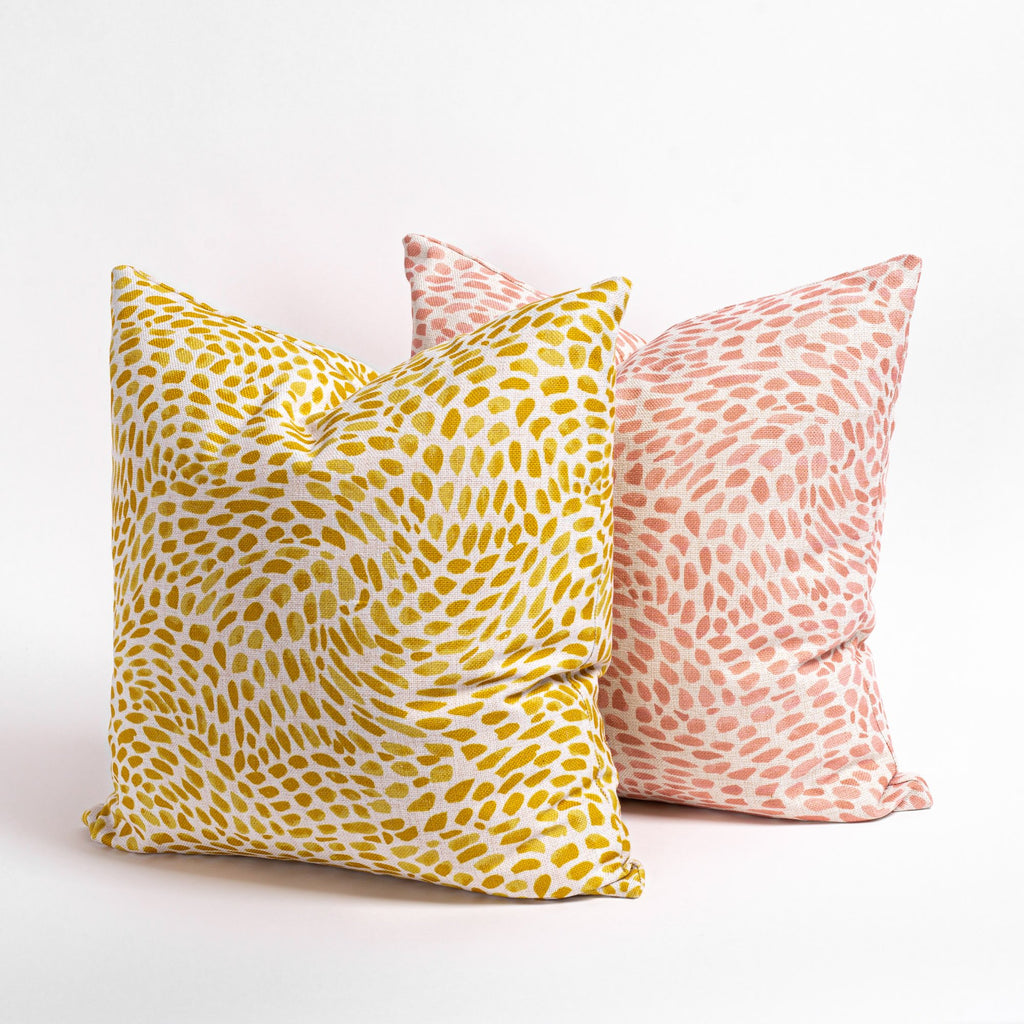 Mazzy swirl print pillows in pink and yellow from Tonic Living