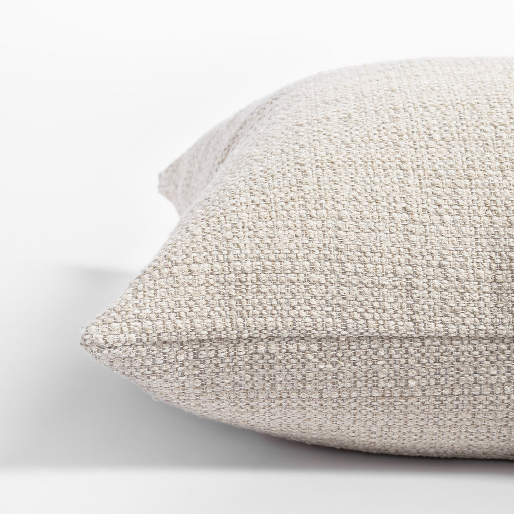 Milly 22x22 Vanilla Cream pillow, a sandy cream nubby textured pillow : close up side view