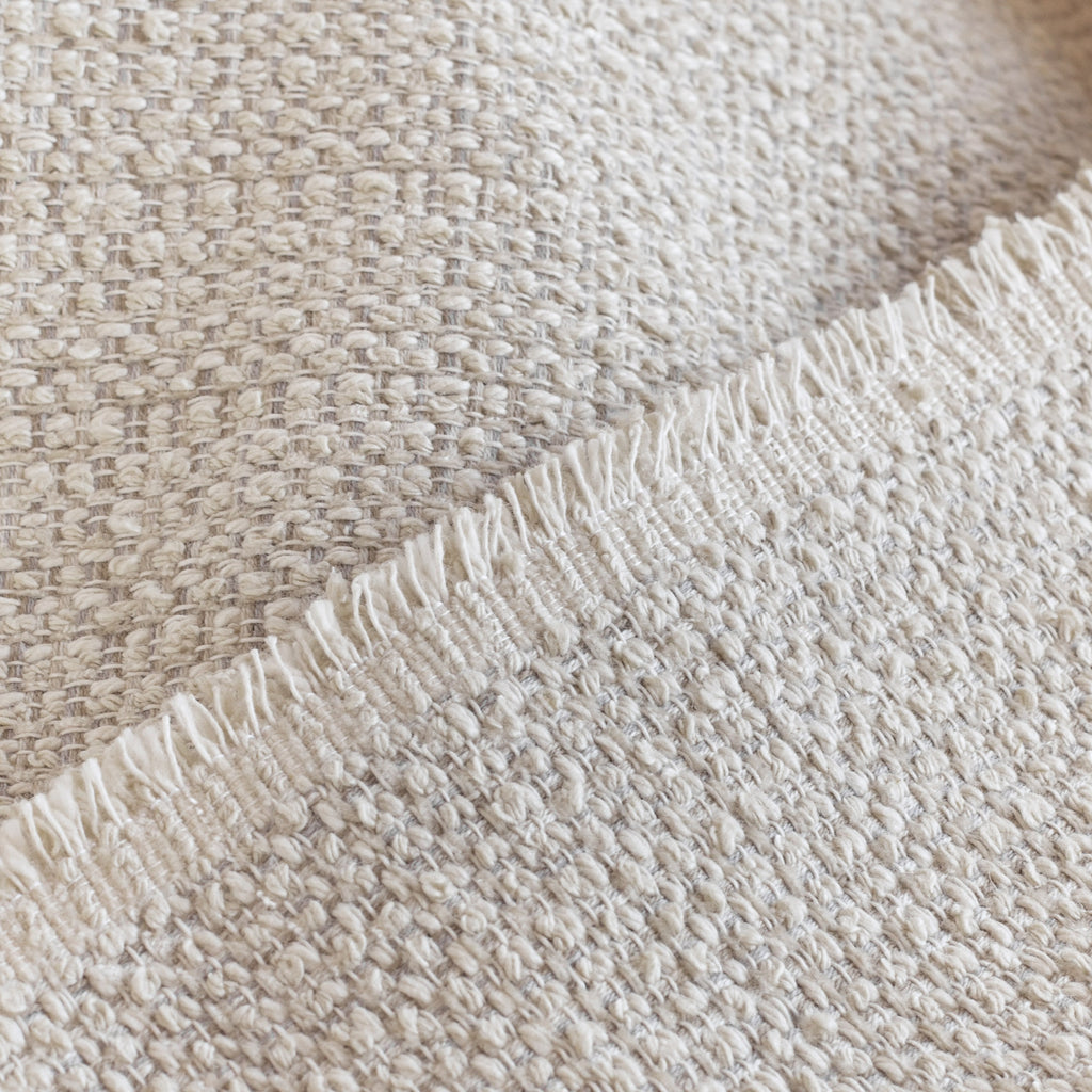 Milly Vanilla Cream, a sandy-beige home decor fabric with a chunky weave : close up view