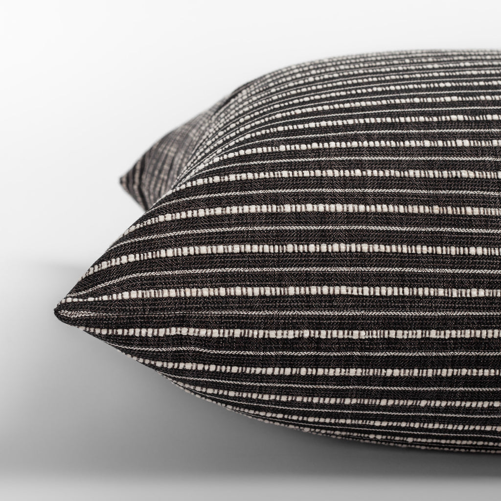 Misto Charcoal Pillow,  a faded black and textured cream stripe pillow : close up side view