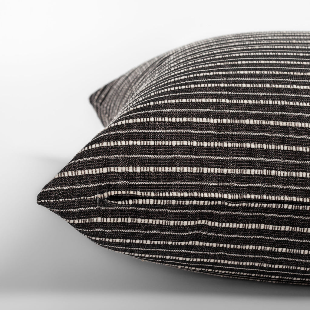 Misto Charcoal Pillow,  a faded black and textured cream stripe pillow : close up zipper detail