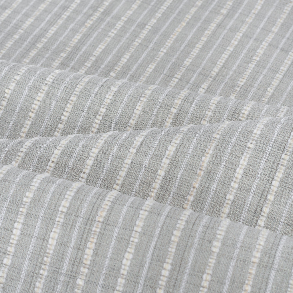Misto Fog Grey, a cool gray and cream horizontal striped Crypton Home performance fabric: soft folds view