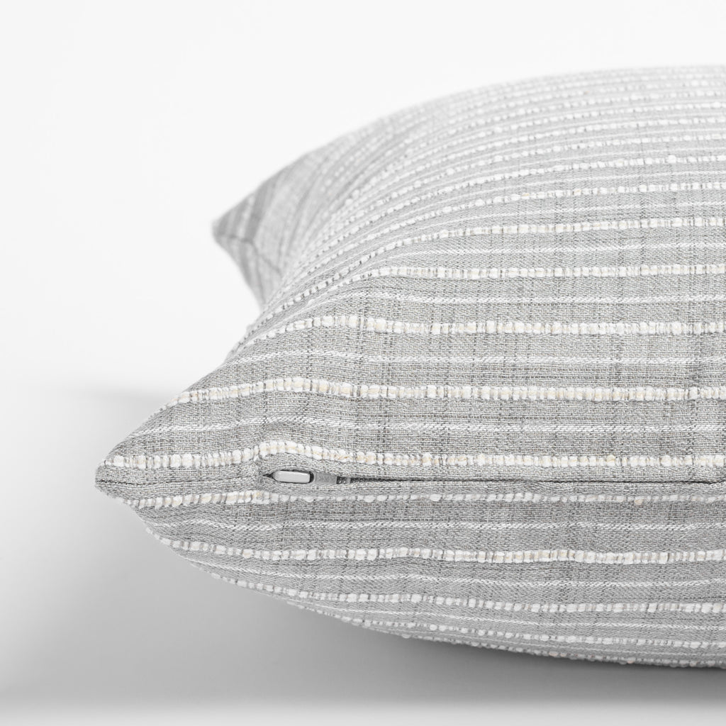 Misto Pillow Fog, a light gray and cream textured stripe pillow : close up zipper detail