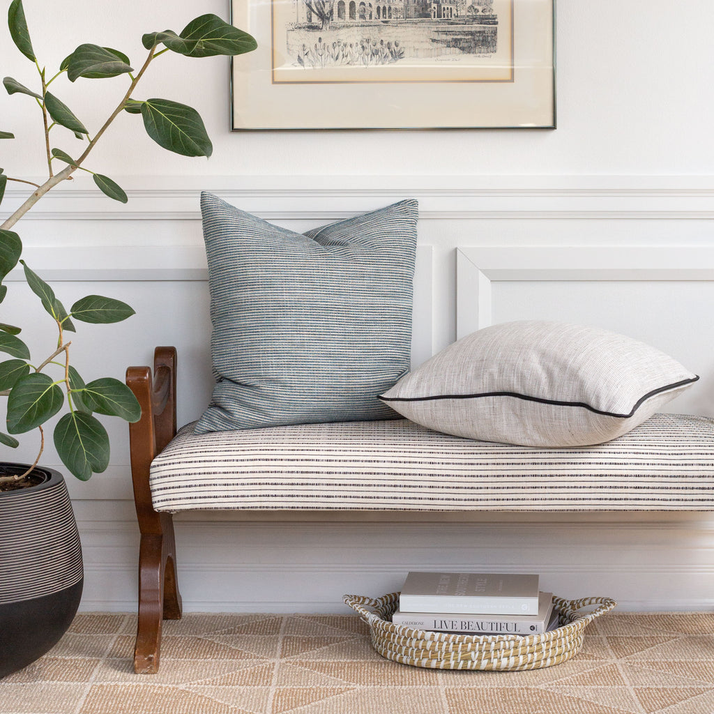Home decor vignette: Nora pearl grey black piped pillow with Marklin seaglass blue on cream and black stripe fabric bench