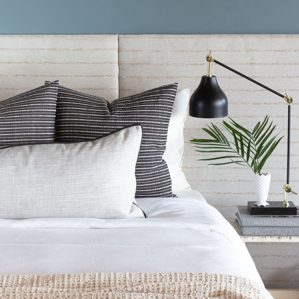 Bed vignette: Nora pearl gray bed bolster and misto black and cream stripe pillows