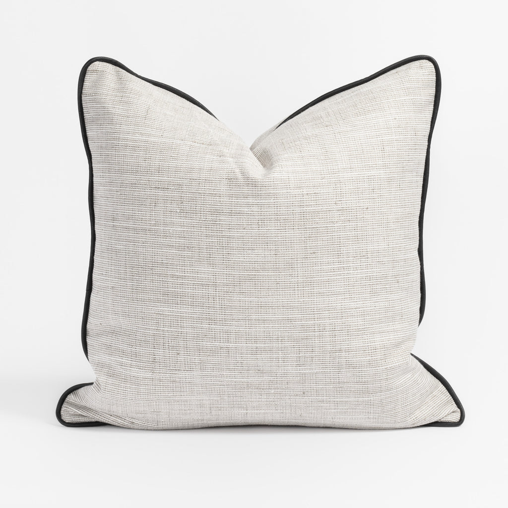 Nora, a pearly pale gray pillow with black piping from Tonic Living