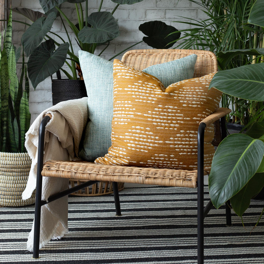 indoor outdoor home decor vignette: Ophelia Turmeric Pillow with Felix Pool Pillow