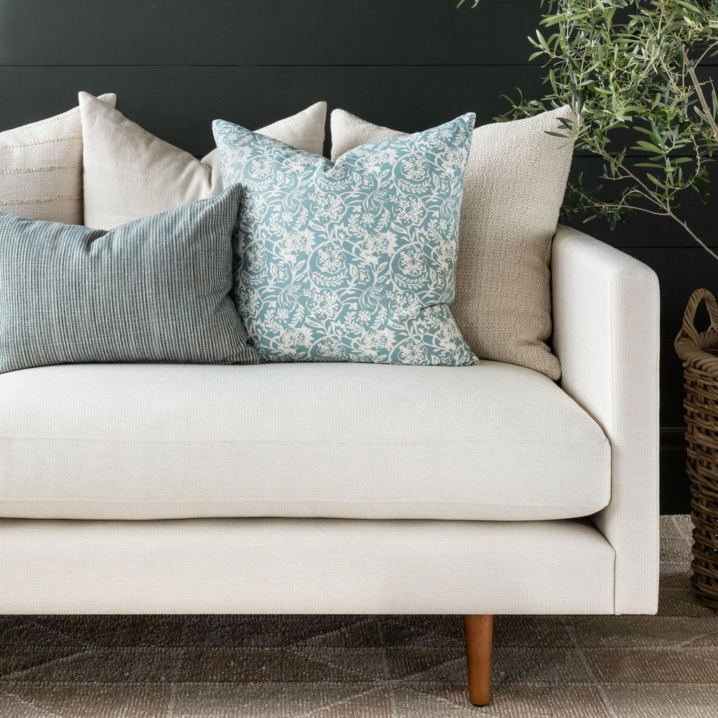 Blue and cream sofa pillow combination : Padma Aqua, Marklin Storm lumbar, and Milly Vanilla