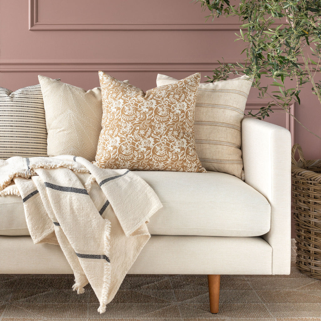 Sofa pillow combination: Padma nutmeg pillow shown with neutral pillows