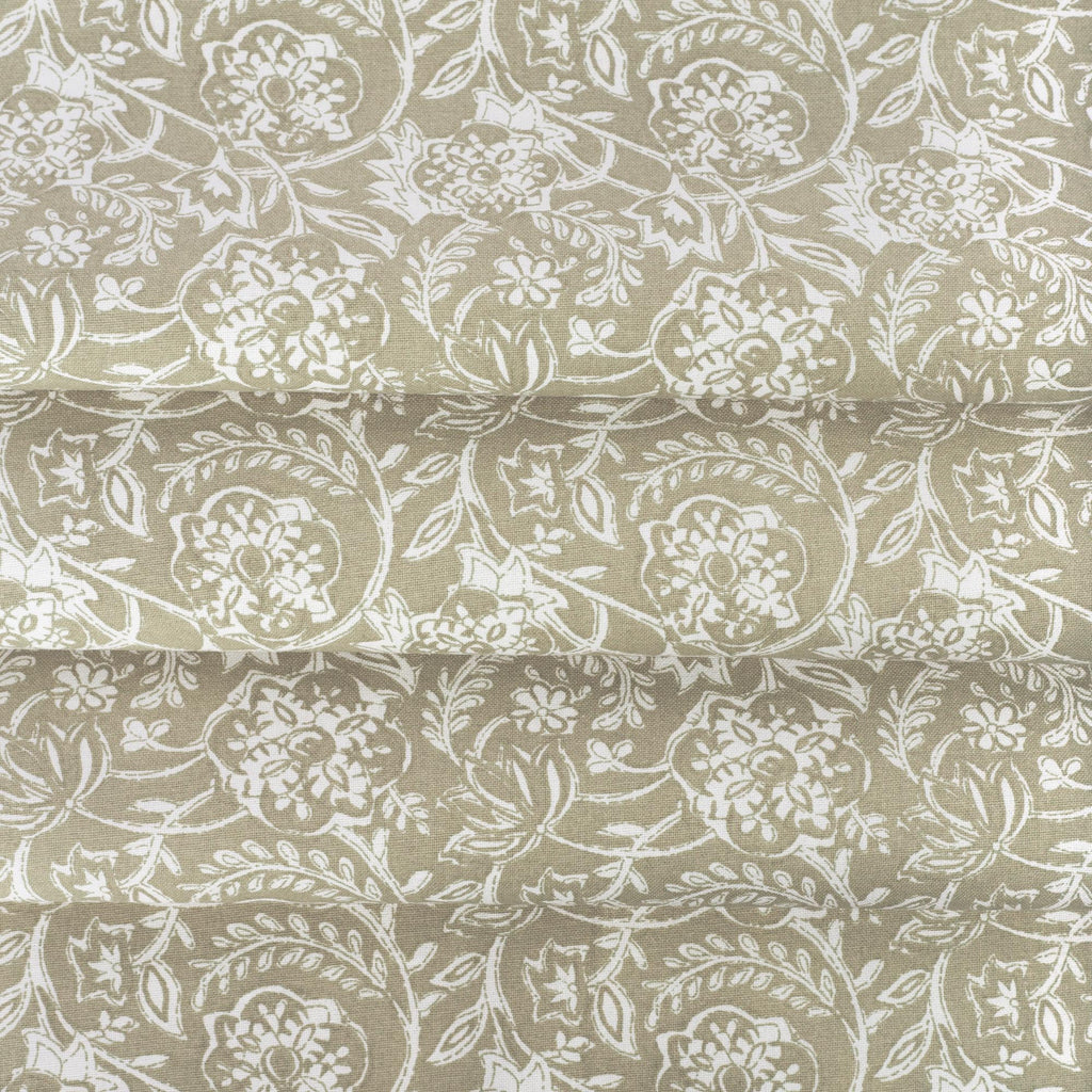 Padma Sand, a khaki beige and cream tapestry block print style cotton fabric: close up view