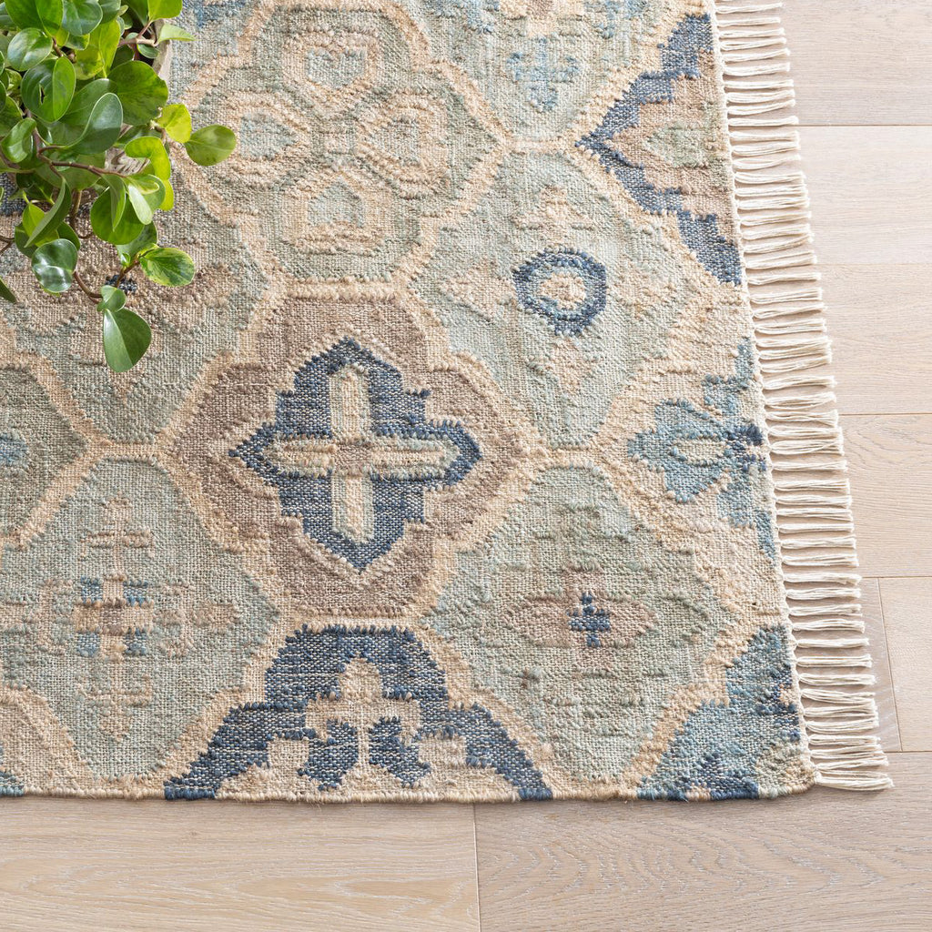 a blue and neutral medallion pattern jute rug