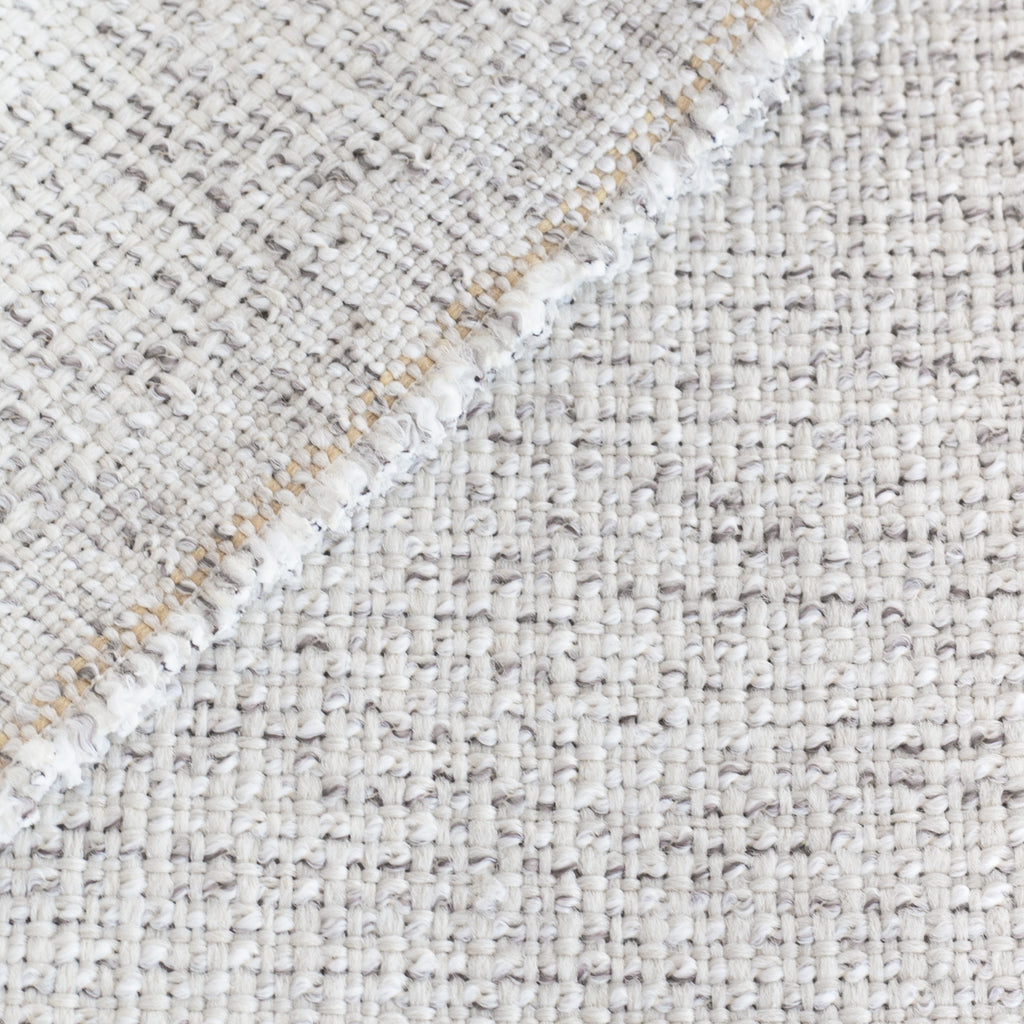 Preston Birch Indoor outdoor fabric, a light cream fabric, with strands of warm gray: close up view