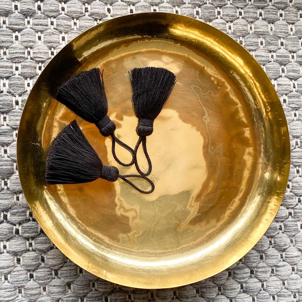 Black tassel trim and Priya brass tray accessory from Tonic Living