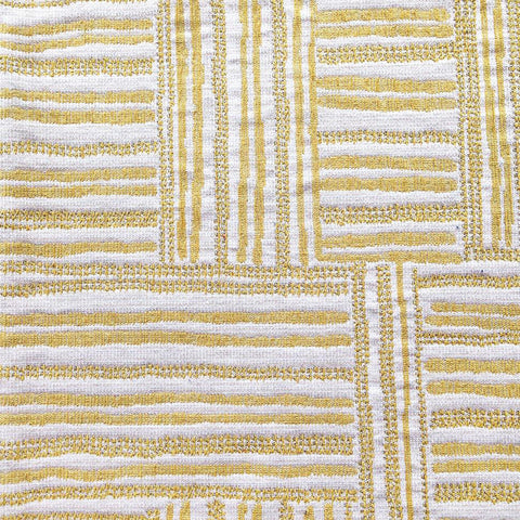 A cross hatched patterned fabric in yellow and cream made of a heavier, woven jacquard. Justina Blakeney Home collection.