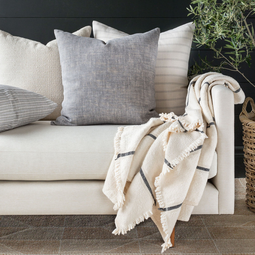 Quinto Shadow pillow combination with Farina Birch, Milly Vanilla pillows and Rafael Cream Throw on a cream sofa.