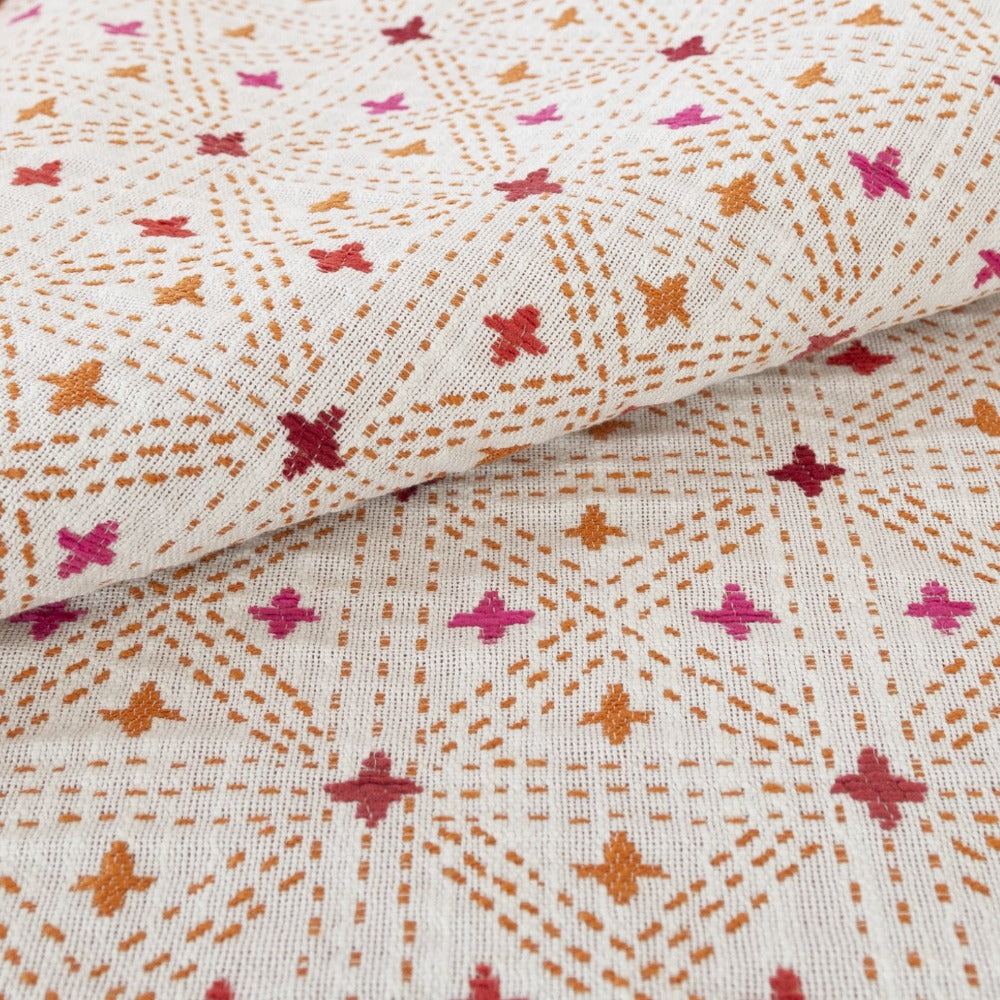 Raya pink and coral embroidered cross hatch fabric from Tonic Living