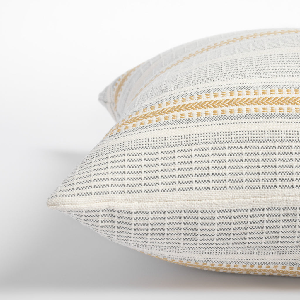 Rhodes Canary, a yellow and grey stripe d indoor outdoor pillow : close up side