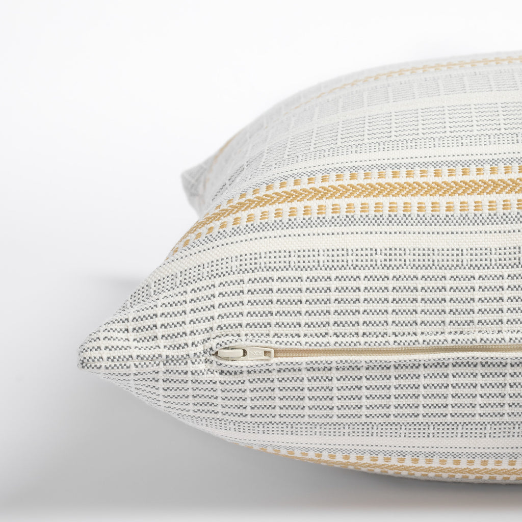 Rhodes Canary, a yellow and grey stripe d indoor outdoor pillow : close up zipper
