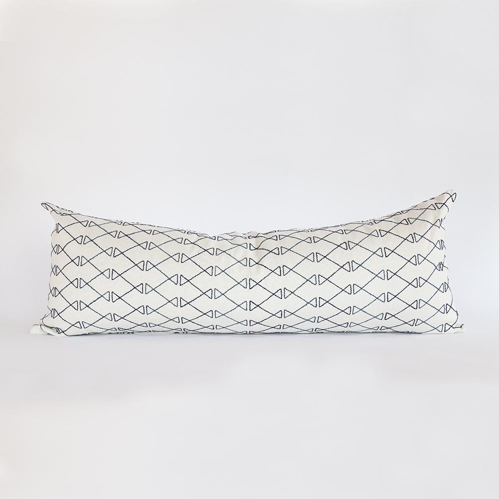 Santo indigo blue embroidery on ivory long bolster pillow from Tonic Living