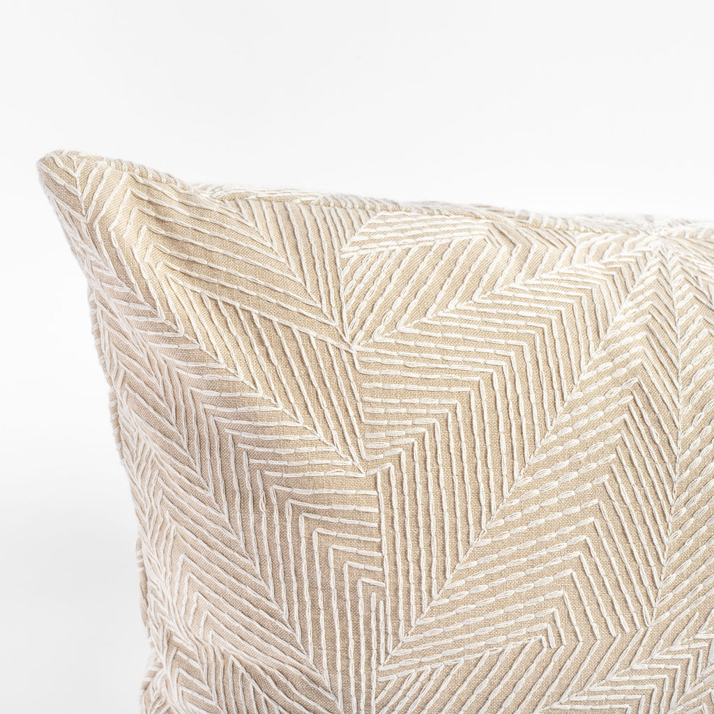 beige geometric embroidery throw pillow close up view