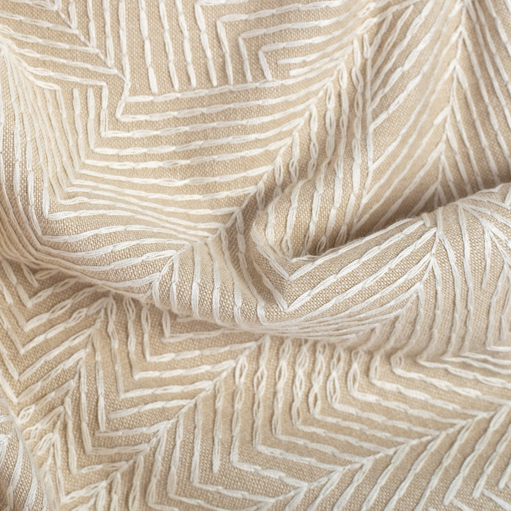 embroidered fabric with a tone-on-tone sandy linen palette