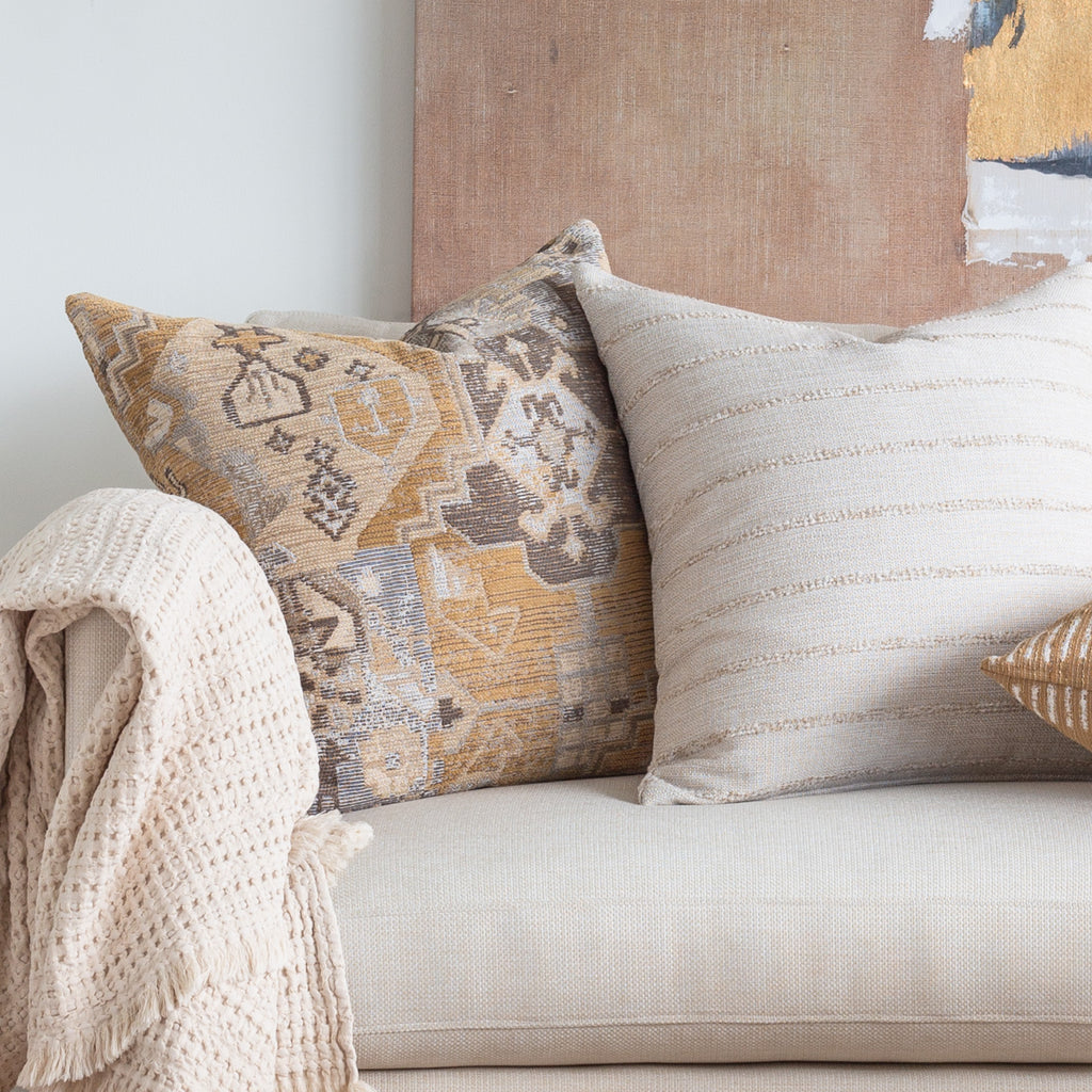 Earthtone decor: Saro Sisal tapestry patterned and handlavet beige textured stripe pillow combination