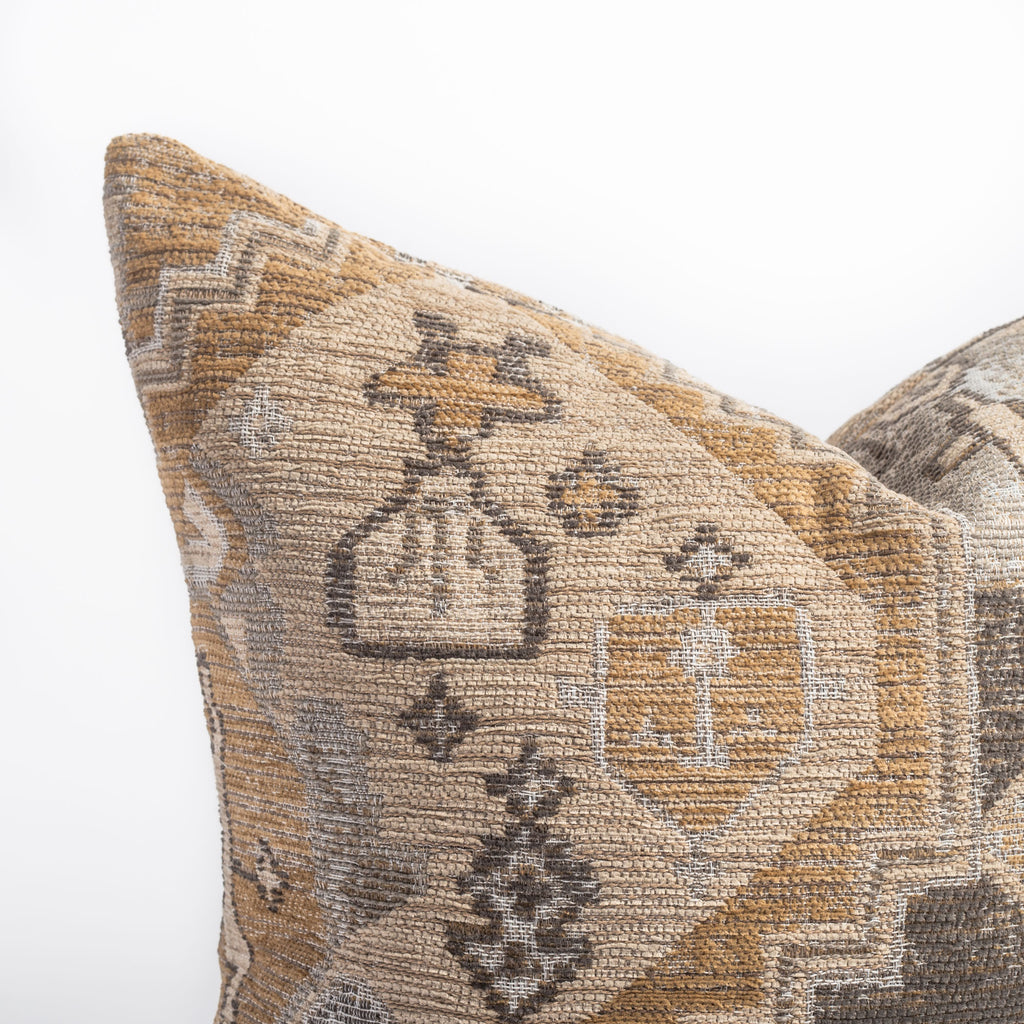 earth tone tapestry pattern pillow detail