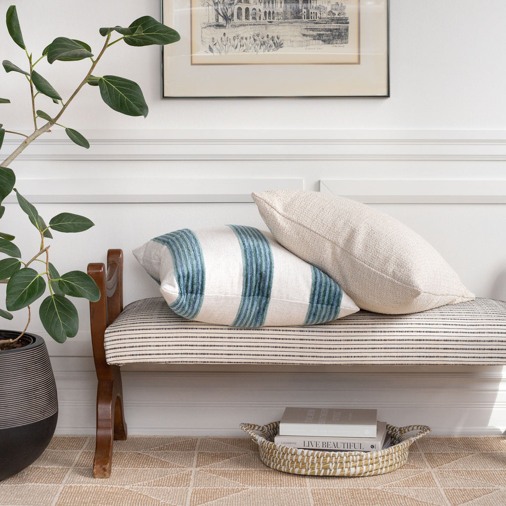 Home Decor vignette: Satori blue stripe and preston heathered cream pillow on Misto cream and black stripe bench