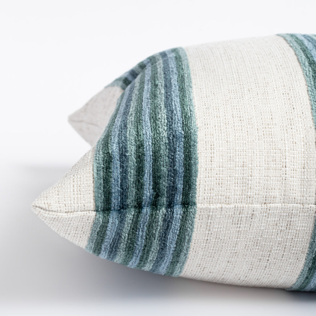 a bold blue green and cream striped pillow with a chenille texture