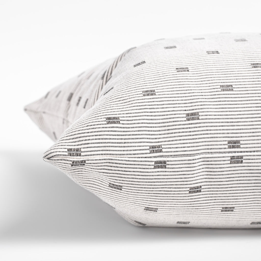 white and black geometric stripe decorative pillow detail