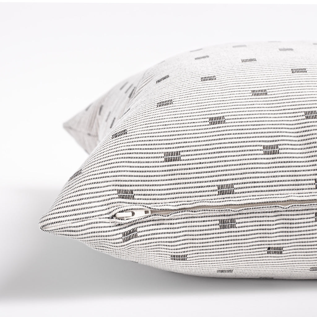 white and black geometric stripe decorative pillow zipper detail