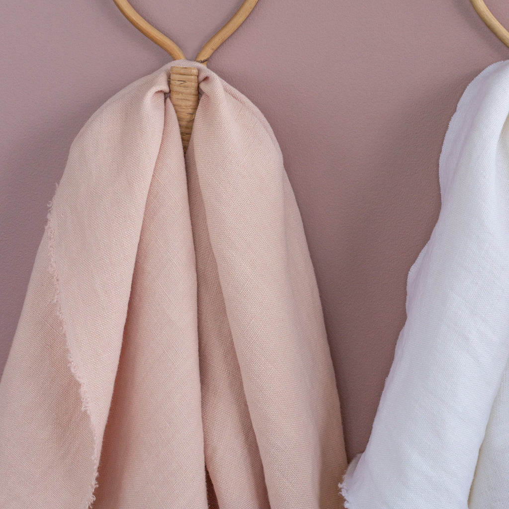 soft pink linen fabric draped on a wall hook