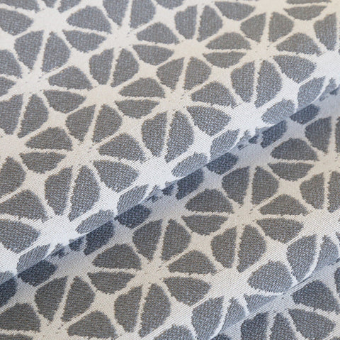 From our High Performance upholstery fabric line is this small-scaled grey and cream weave. Perfect for medium to heavy weight furniture upholstery projects, seat cushions, pet beds and many other home decor projects.