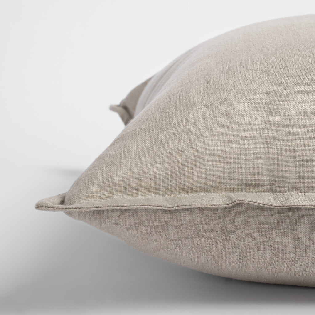 Tuscany Pumice, an earthy stone gray linen pillow with flange detail : close up view