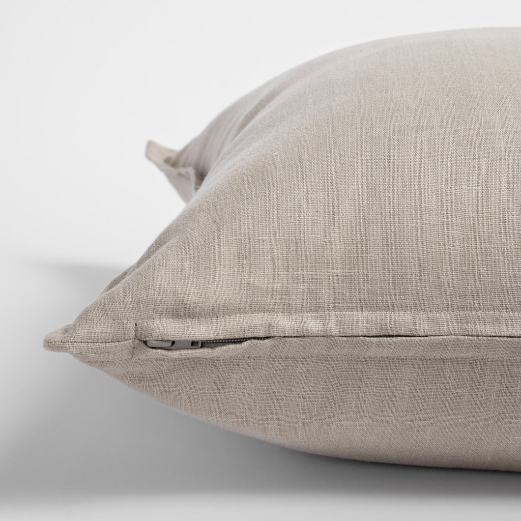 Tuscany Pumice, an earthy stone gray linen pillow with flange detail : zipper view