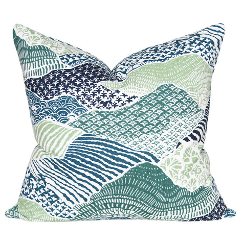 A Japanese paper inspired pillow in saturated colours of indigo, teal, light olive green and emerald green.