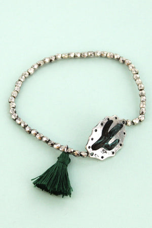 Burnished Silvertone and Patina Cactus with Dark Green Tassel Stretch Bracelet
