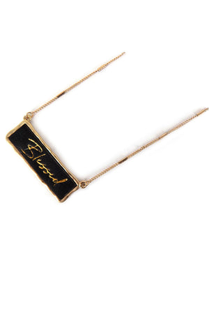 Goldtone and Black Faux Leather 'Blessed' Bar Pendant Necklace