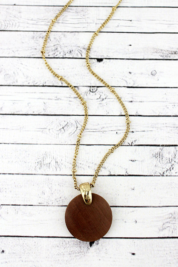 Crave Goldtone and Brown Wood Disk Pendant Necklace